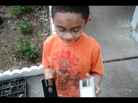 A 5 year old explains a data tape and floppy disk to me