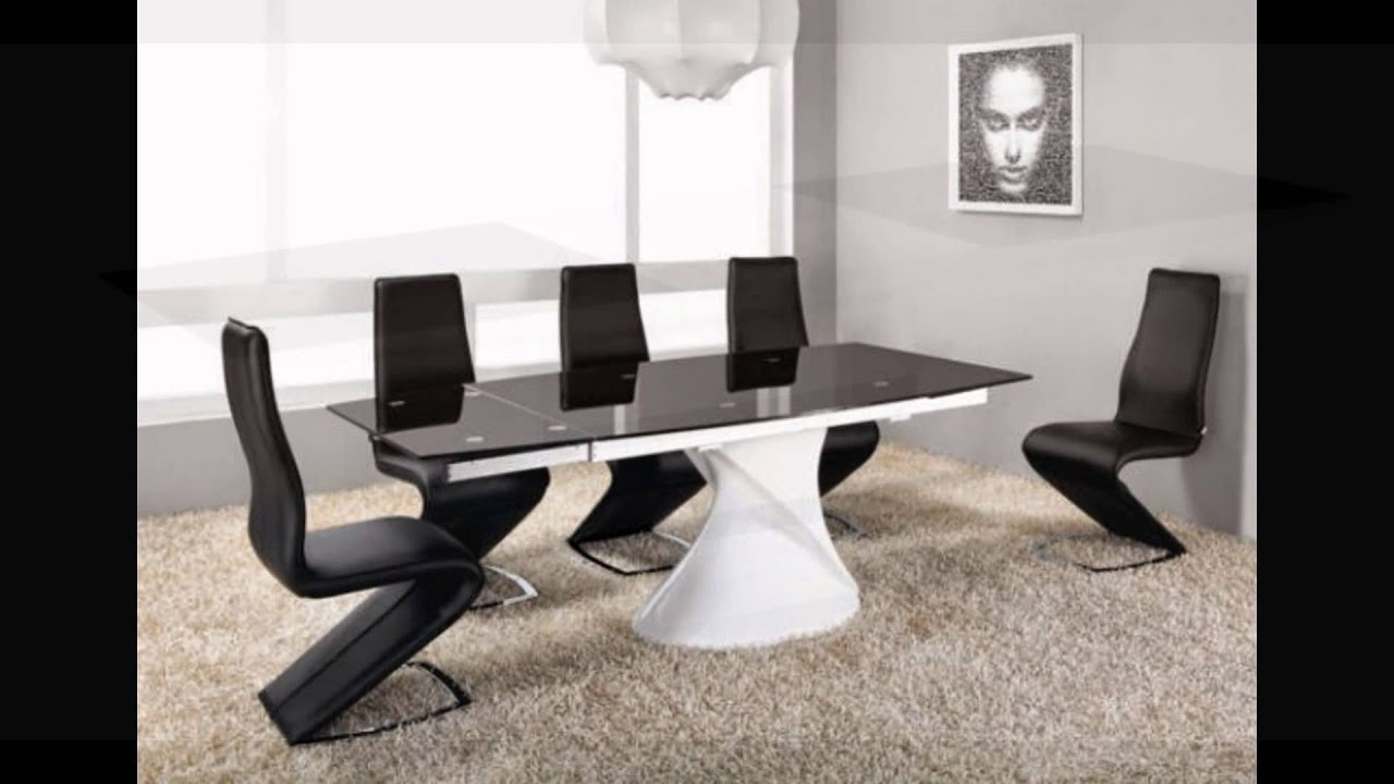 Extending white high gloss black glass dining table and 8 chairs
