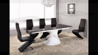 Extending white high gloss black glass dining table and 8 chairs set