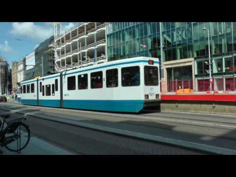 Trams On Rokin Street In Amsterdam, The Netherlands