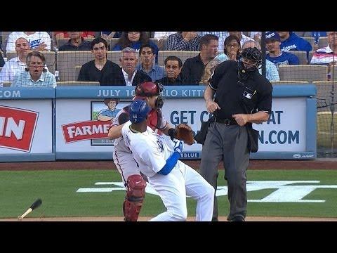 Puig's bat flip nearly hits catcher, umpire