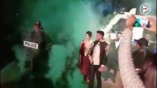 Smoke and sirens: Police escort matric dance couple