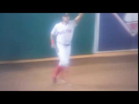 Chris Young leaps at the wall to make the catch
