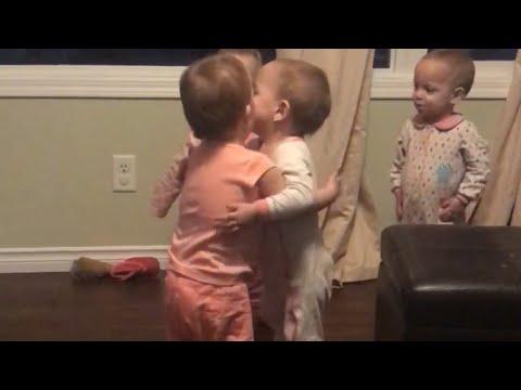 Babies hugging babies - 980694