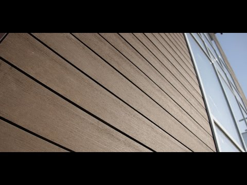 Отделка фасада обычного деревянного дома