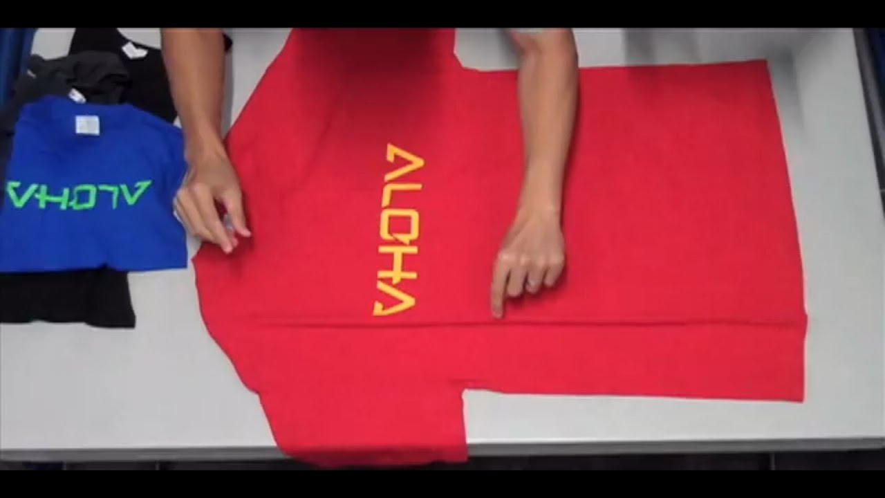 How to fold a t shirt in 2 seconds japanese way of for Japanese way to fold shirts