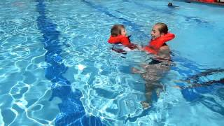 Dominique swimming lessons Summer 2011(Dominique's first time wearing a life jacket in the pool! Video 1 of 3., 2011-08-05T18:14:36.000Z)