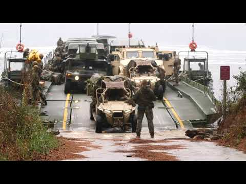 Marines conducting a wet gap crossing to transport Marines, tactical equipment, and vehicles (2020)