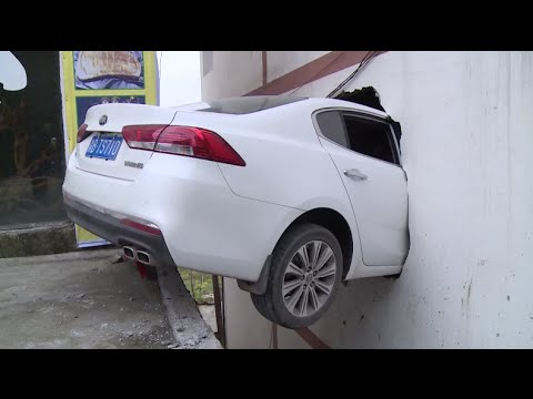 Car Penetrates Wall after Driver Mistakes Accelerator for Brake