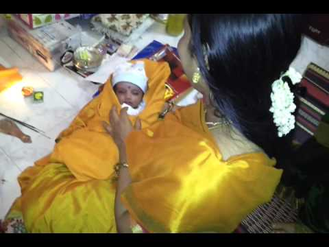 Chatti sister acchu applying kajal on the babys eyes