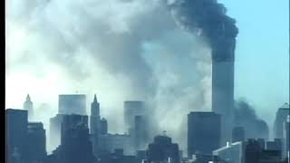 The Collapse Of The  North Tower With Large Billowing Smoke Aftermath (Distant View)