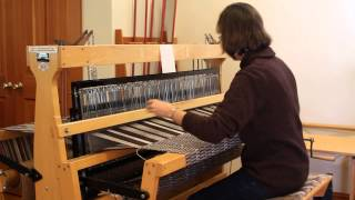 Wool weaving on a loom at Warm Valley Orchard on Orcas Island