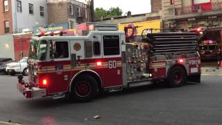 FDNY ENGINE 60 RETURNING TO QUARTERS ON 143RD ST. IN THE MOTT HAVEN AREA OF THE BRONX, NEW YORK.