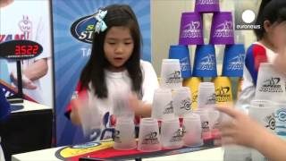 Mini cup stacking world champions show off their lightning-speed skills