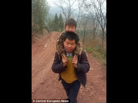 A Single Dad Walks 18 Miles a Day to Carry His Disabled Son to School