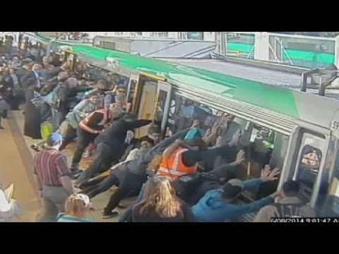 Mind the gap: Commuters push train to save trapped man in Perth