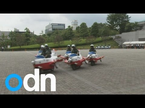 Japanese air force ride on plane-shaped scooters to celebrate 60th anniversary