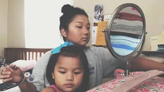 Hmong music, doing makeup & kid in the way