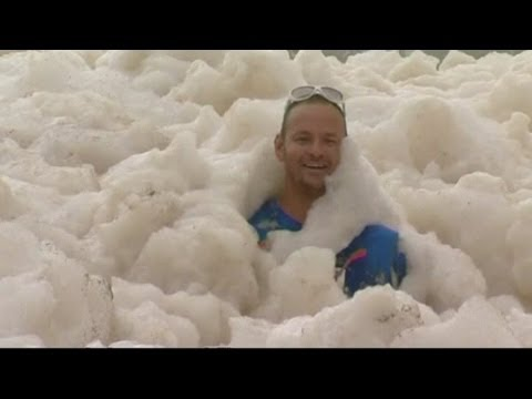 Foam fills Australian town during wild weather after tropical cyclone Oswald