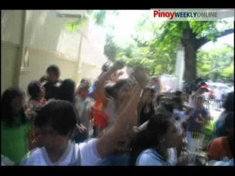 Gabriela women storm gates of Malacanang Palace to protest oil price hikes