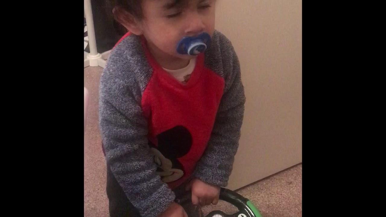 Kid Playing With Bobby Car While Half Sleep