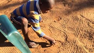 Kid drawing car | Mozambique