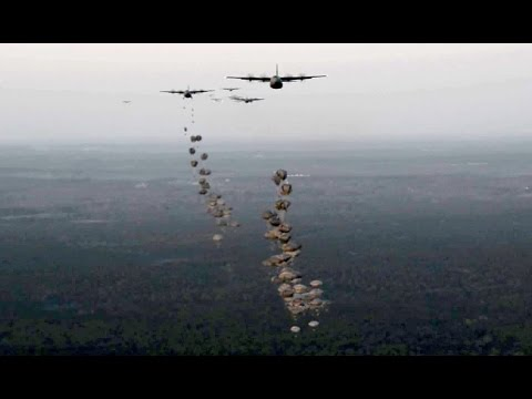 USA and British Army Paratroopers Conduct Static Line Jumps