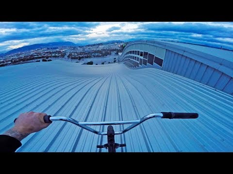 SKETCHY ROOFTOP HILLBOMB ON BMX!!