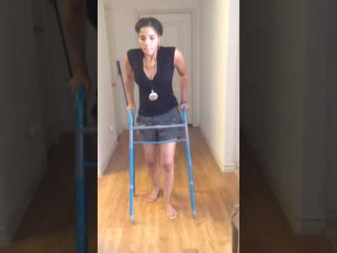 Multiple Sclerosis battle with walker in 2014, prior to being confined to a wheelchair again.