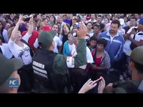 Venezuelans cross shortly opened border with Colombia to buy goods