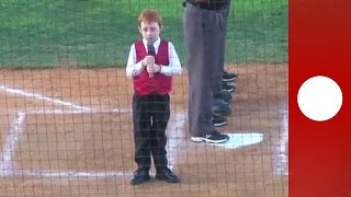 Little boy battles hiccups singing national anthem at baseball game