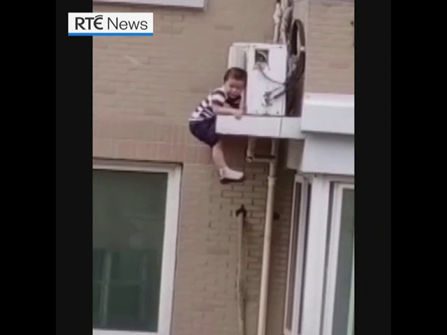 Man catches toddler falling from fifth floor in China - RTÉ News