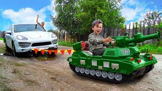 Senya on a tank saving a Car stuck in the mud