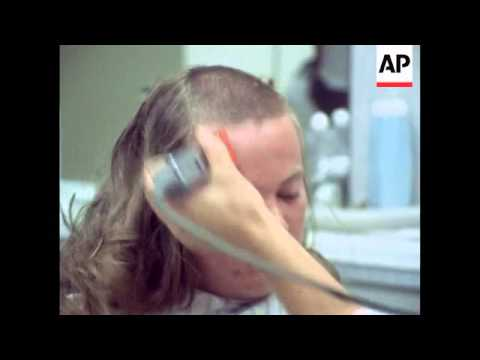 Army recruits with long hair get regulation army haircuts - 1973