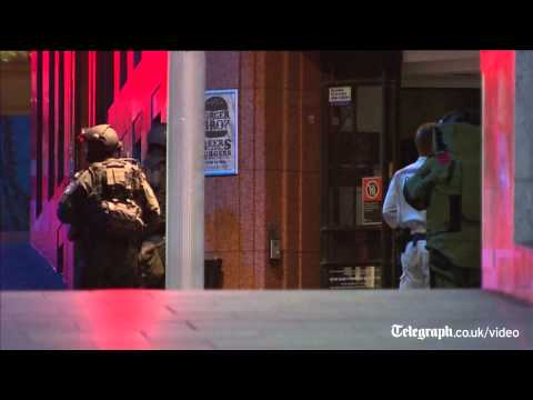 Sydney cafe siege: gunfire breaks out after hostages flee