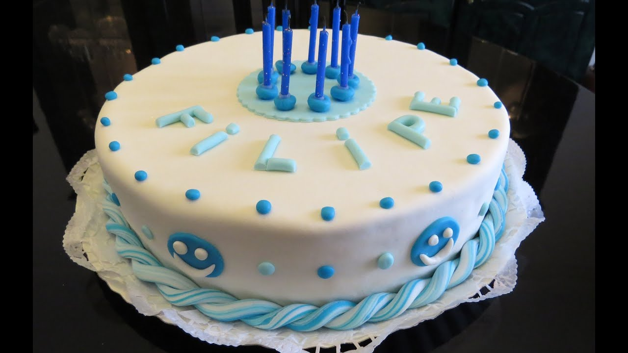 Cake decorating with sugarpaste or fondant blue and white ...