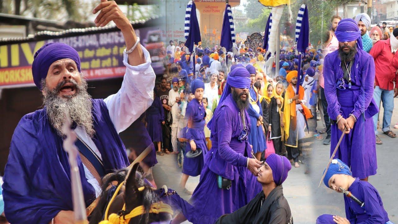 Download Nihang Singh Playing Gatka In Nagar Kirtan ,Bidhicandiye / DamDami Taksaal / Nilian Fouja / Akaal