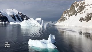 Baixar Antarctica is losing ice at an accelerating rate. How much will sea levels rise?