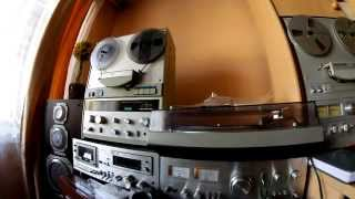Yumi Arai on reel to reel tape recorder