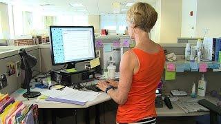 Dallas Morning News fitness writer Leslie Barker  shows off her standing desk