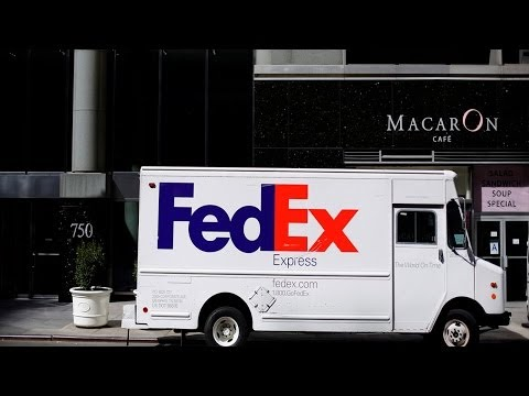 FedEx Cuts 2014 Profit Guidance as Winter Hurts Bottom Line