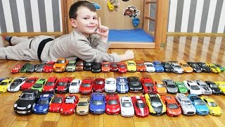 Ali plays with his cars collection