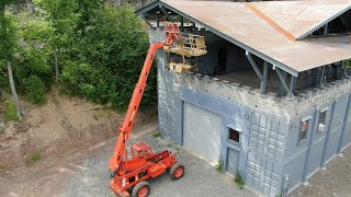 Getting the scissor lift off the roof