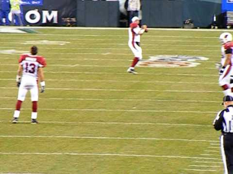Kurt Warner and Matt Leinart having catch before Philadelphia Eagles game on Thanksgiving night