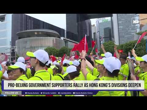 Pro-Beijing government supporters rally as Hong Kong's divisions deepen