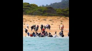 Высадка мигрантов из Африке на испанском пляже Дель Кануэло