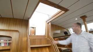 Retractable washboards in the saloon of a Hallberg-Rassy 64