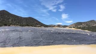 Heap Leach Video - Clifton Mine - pregnant solution pond