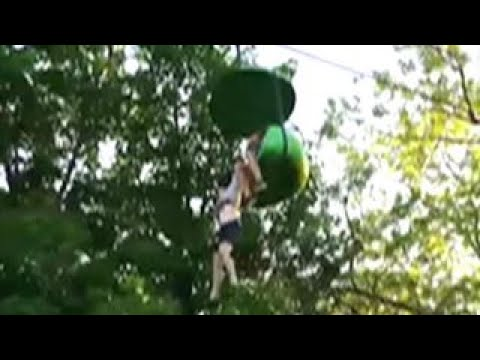 Crowd catches girl falling from amusement park ride