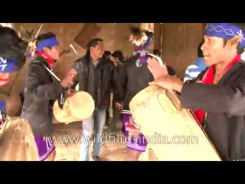 Tourists have fun dancing and singing with friendly Garo tribes